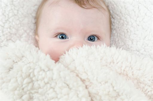 baby-photo-shy-newborn-baby-with-blue-eyes-and-white-fur-blanket-photo-.jpg