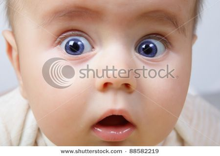 stock-photo-head-shoot-of-cute-baby-with-blue-eyes-and-surprise-look-88582219.jpg